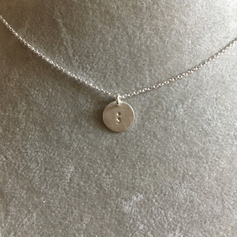 Semicolon necklace hand stamped Sterling silver. Your story image 0