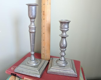Two Silver Colored Candlesticks, 6 and 7.75 Inches Tall, Weigh 14.8 oz together