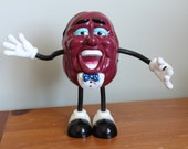 California Raisin AM FM Radio Battery Included, Works Great, Missing a Microphone in Hand, 7.5 Inches Tall, Bendable Arms and Legs