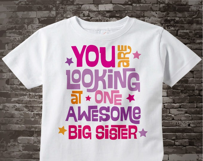 You are looking at one Awesome Big Sister T-shirt or Onesie Bodysuit with Pink and Purple letters 02222013b