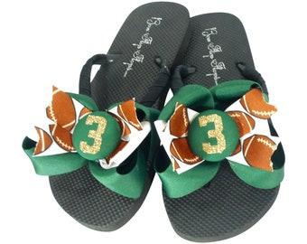 9b729decdbd4 Football Glitter Number Bow Flip Flops