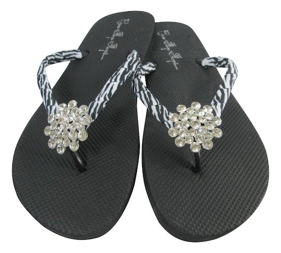 7885d1c32fecd2 Rhinestone Flip Flops with Zebra Bling jewels on flat black