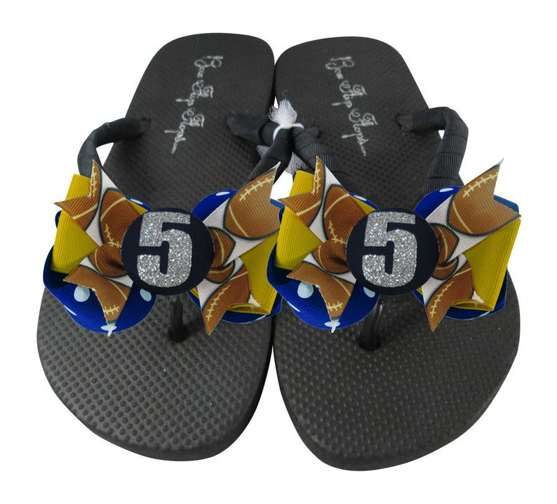 fba98b4dc3ae Glitter Number Football Bow Flip Flops. Royal Blue Gold