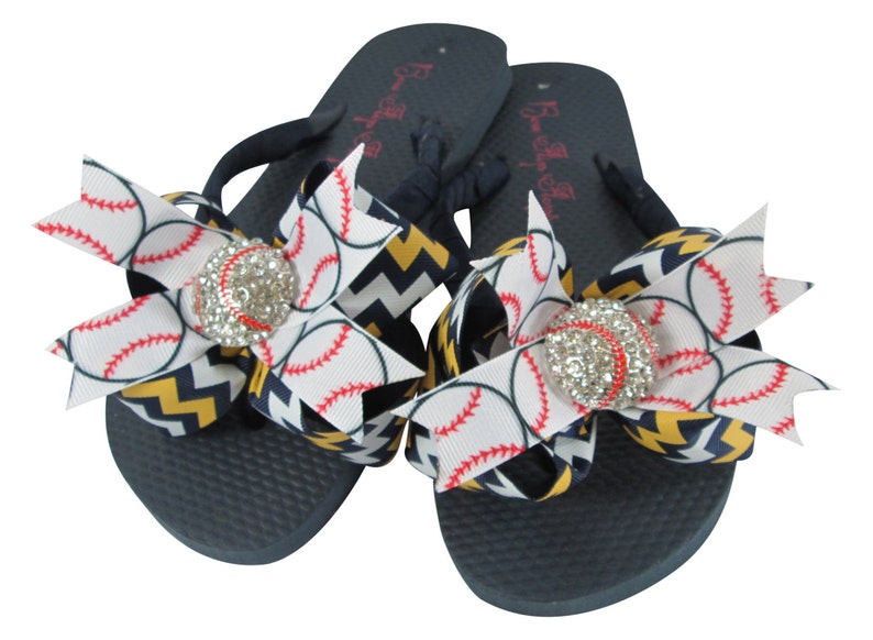 b8f2e146a366b0 Baseball Bling Rhinestone Bow Flip Flops Gold and Navy