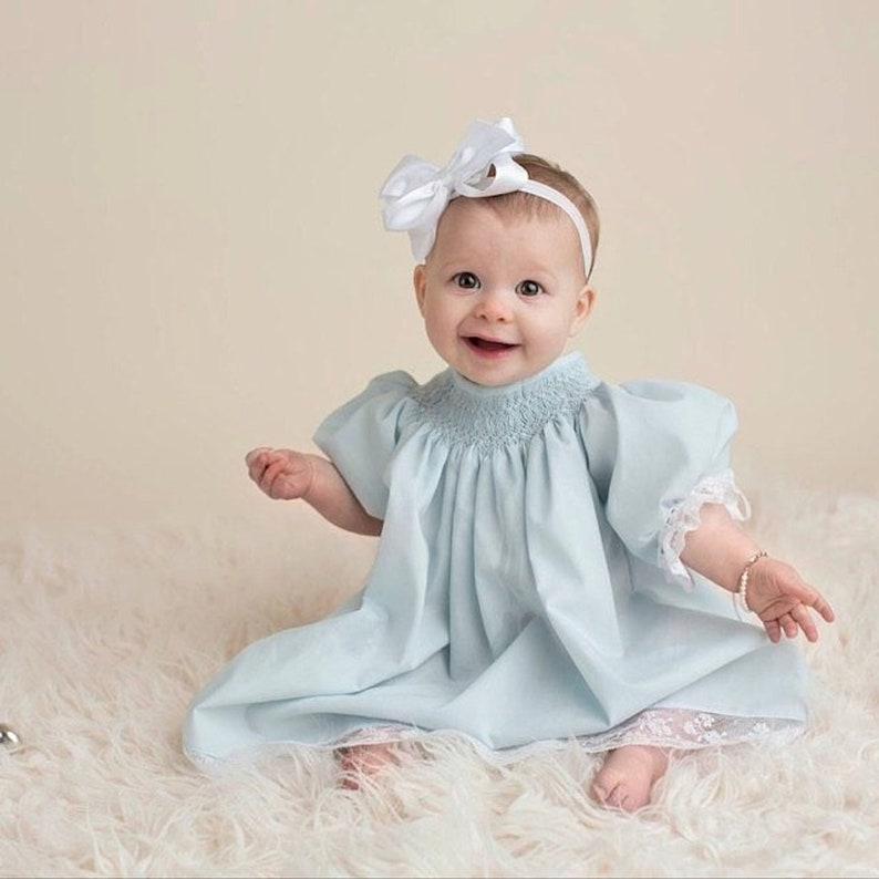 ef1a8952b9299 Heirloom Hand Smocked Dress and Matching Bonnet Pastel Blue with Ivory Lace