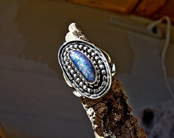 Sterling Silver ring with lab created 6.25 mm opal stone RF651