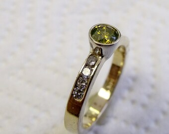 Bright Yellow Diamond in Yellow Gold ring with White Diamonds Channel set in band RF616