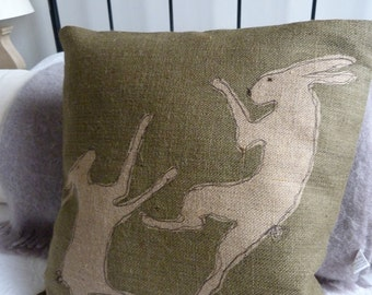 hand printed olive tumbling hare cushion cover