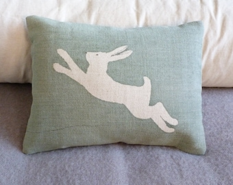 hand printed muted duck egg leaping logo hare  cushion