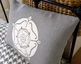 hand printed muted blue yorkshire rose cushion
