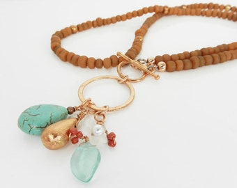 Long Copper and Turquoise Necklace Matte Rust Beads Combined with Aqua Charms