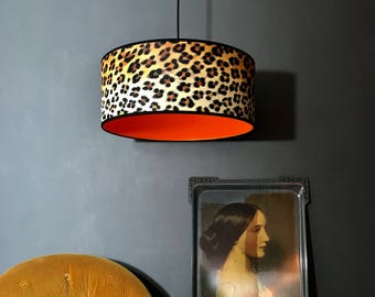 Handmade Wild Leopard Print Wallpaper Lampshade with Neon Orange Lining. Available in 8 different sizes.