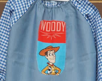 Kids art smock Fits age 5 to 8. Back to school orange art smock, long sleeve waterproof front craft apron. Blue, check. Woody.