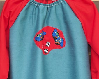 Kids art smock Fits age 5 to 8. Back to school art smock, long sleeve waterproof front craft apron. Red sleeves, racing cars.