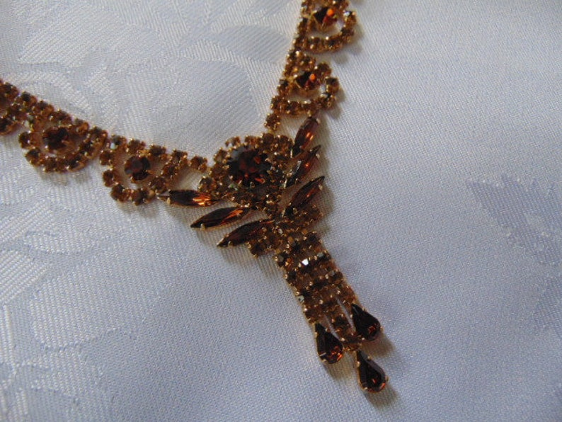 stunning deep amber coloured rhinestone necklace 16 inches long plus the drop tassel