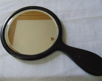 Black real ebony hand mirror 1930 with a silver letter R on the back