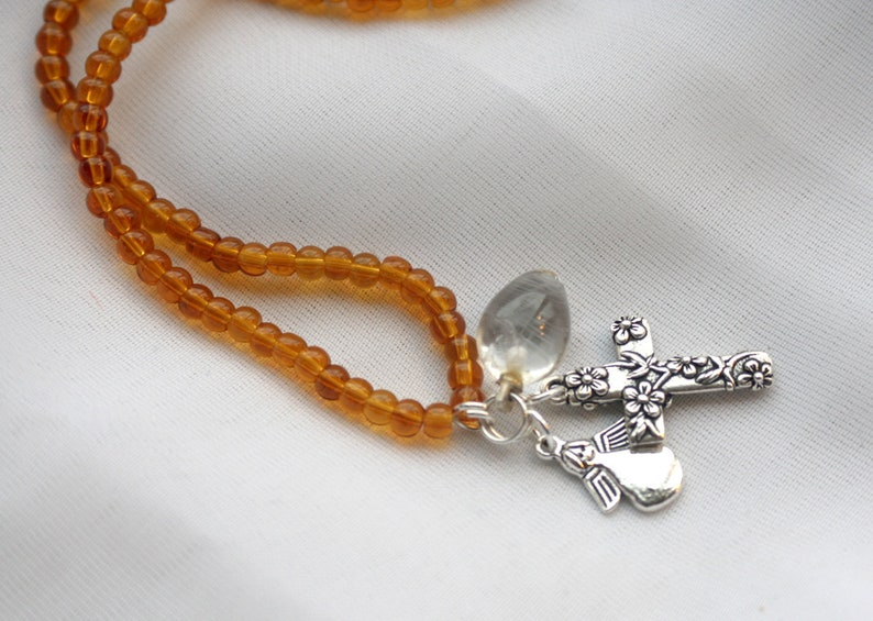 Amber Necklace with Floral cross angel and quartz charms image 0