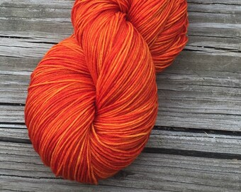 Hand Dyed Sock Yarn Lusty Wench Orange 463 yards superwash merino nylon fingering Treasured Toes pumpkin mango soft ready to ship
