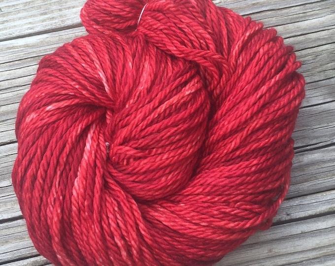 Hand Dyed Bulky Yarn Ruby Daggers red yarn 100% superwash merino wool 106 yards crimson ruby red bulky weight yarn treasure goddess