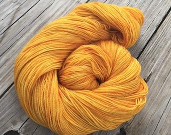 hand dyed sock weight yarn Poseidon's Trident Gold Shawl Length Superwash Merino Cashmere Nylon MCN 600 yards fingering weight yellow orange