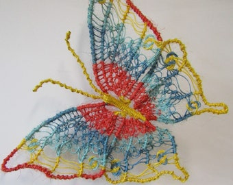Macrame Butterfly wall decoration, handmade using hemp string painted red, blue, yellow