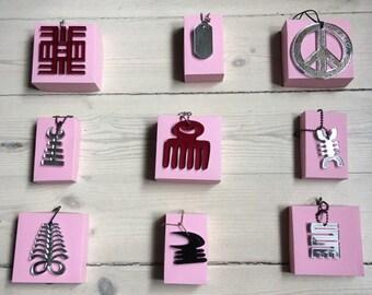 Adinkra symbols in lucite -  Duafe, Aya, Odo nnyew, asase, Osidan