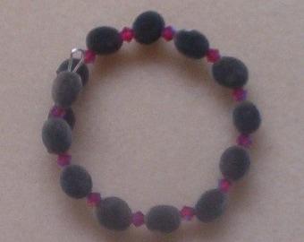 Hawaiian mgambo seed bracelet with 4mm light siam 2AB Swarovski crystal (dark pink), handmade in Hilo, Hawaii