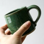 Two stoneware pottery mini mugs - glazed in forest green