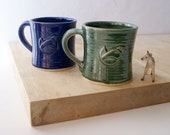 Set of two wren mugs glazed in forest green and ocean blue - hand thrown stoneware pottery