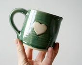 Pouring jug for milk with heart motif - hand thrown in stoneware glazed in forest green