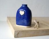 SECONDS SALE - Flat bottle heart bud vase glazed in ocean blue