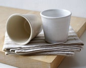 Set of two stoneware pottery beakers - glazed in brilliant white and simply clay