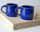 Two tankard style stoneware pottery tea mugs - glazed in ocean blue