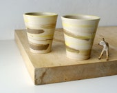 Set of two stoneware pottery beakers - glazed in simply clay with slip decoration