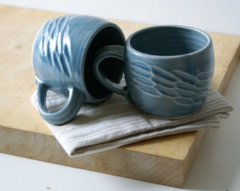 Two stoneware pottery faceted mugs - glazed in ice blue