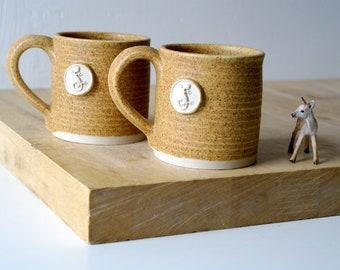 Set of two natural brown mugs - with salamander design