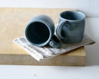 Two tankard style stoneware pottery tea mugs - glazed in ice blue