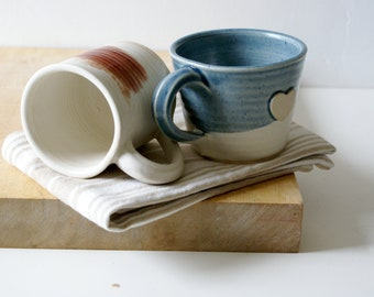 Set of two mismatched mugs - glazed in ice blue and vanilla cream