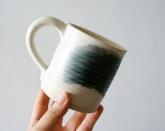 Painter's mugs - set of two vanilla and black straight sided mugs