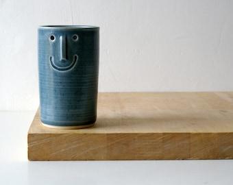 One ceramic vase with face design - glazed in ice blue