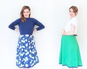 2 in 1 reversible wrap skirt . sheep on one side . kelly green on the other .small.medium
