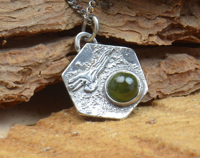 Green Tourmaline and sterling silver raw pendant. Artisan eagle pendant nature.Unique.Sterling silver.Metalsmithing