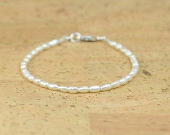 Tiny white pearls bracelet. Rice shape