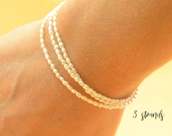 Super tiny white pearls bracelet.Triple Double or single wrap bracelet