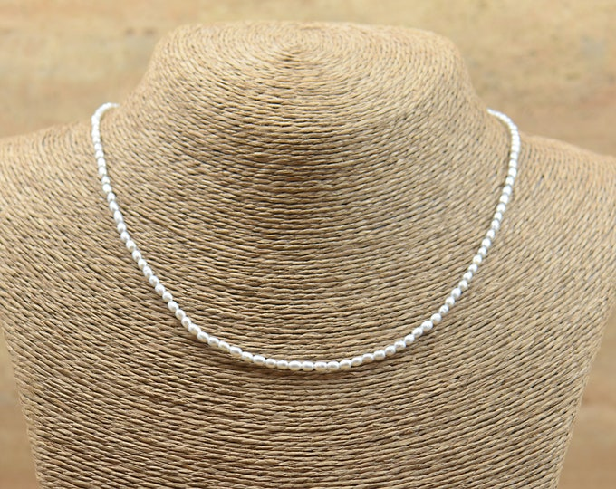 Tiny rice light grey pearls necklace.Sterling silver clasp