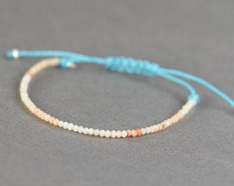 Tiny orange opal bracelet