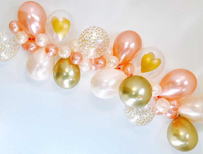 32b4373539e Rose Gold Balloon Garland Rose Gold New Chrome Gold   Peach