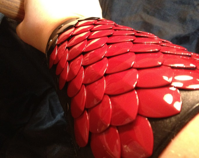 Red Dragon Scale Bracer with Black Scale Trim