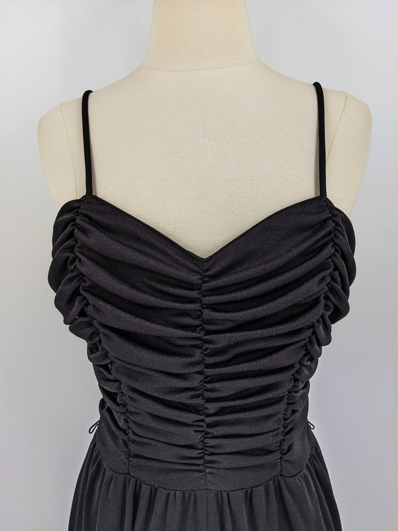 small 1970s black jersey pantsuit romper with ruched sweetheart bodice and spaghetti straps vintage 70s disco jumpsuit