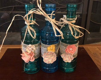 Set of 3 Country style decorative bottles.